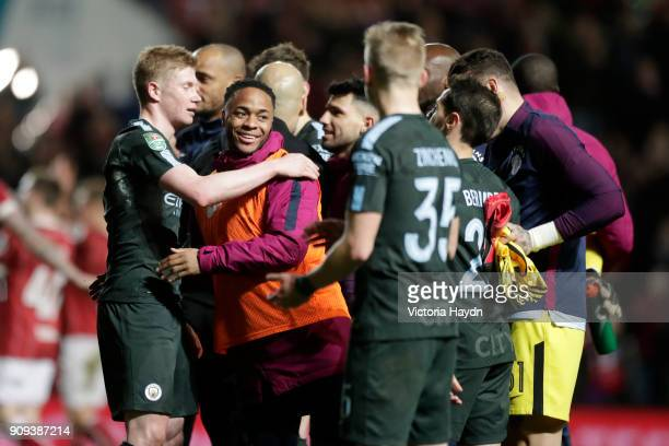 Kevin De Bruyne and Raheem Sterling of Manchester City celebrate victory with teammates after the Carabao Cup semifinal second leg match between...