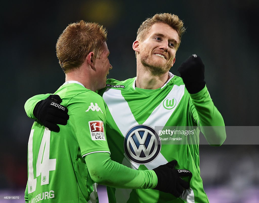 Kevin De Bruyne celebrates scoring his second goal with Andre Schuerrle of Wolfsburg during the Bundesliga match between VfL Wolfsburg and 1899 Hoffenheim at Volkswagen Arena on February 7, 2015 in Wolfsburg, Germany.
