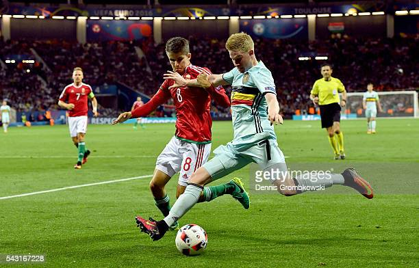 Kevin De Bruyne of Belgium and Adam Nagy of Hungary compete for the ball during the UEFA EURO 2016 round of 16 match between Hungary and Belgium at...