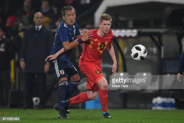 Kevin De Bruyne of Belgium and Yosuke Ideguchi of Japan compete for the ball during the international friendly match between Belgium and Japan at Jan...
