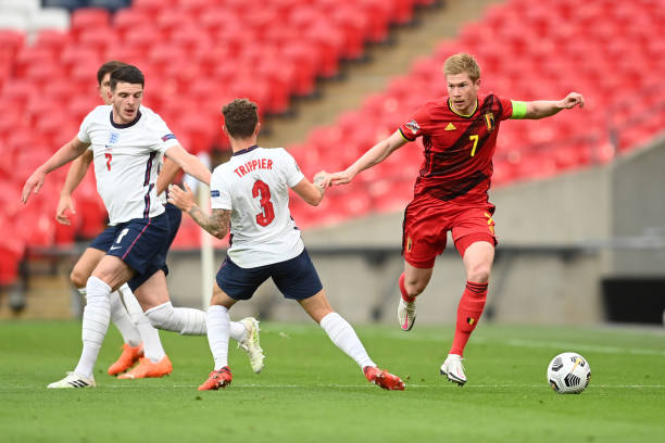Kevin De Bruyne of Belgium battles for possession with Declan Rice of England and Kieran Trippier of England during the UEFA Nations League group...