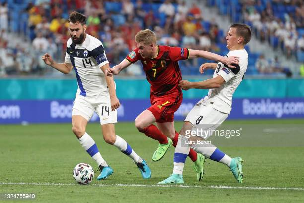 Kevin De Bruyne of Belgium battles for possession with Tim Sparv and Robin Lod of Finland during the UEFA Euro 2020 Championship Group B match...