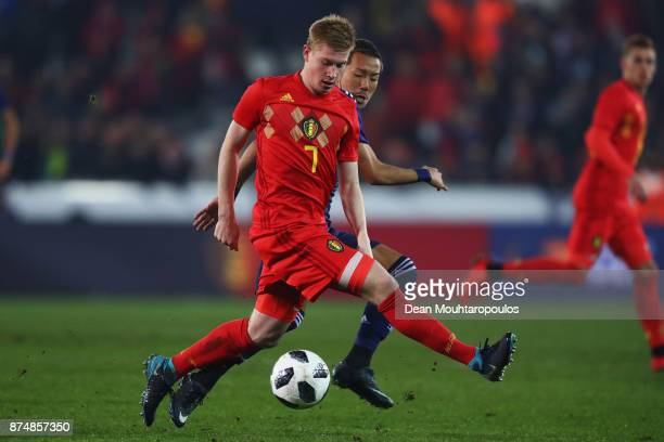 Kevin De Bruyne of Belgium battles for the ball with Yosuke Ideguchi of Japan during the international friendly match between Belgium and Japan held...