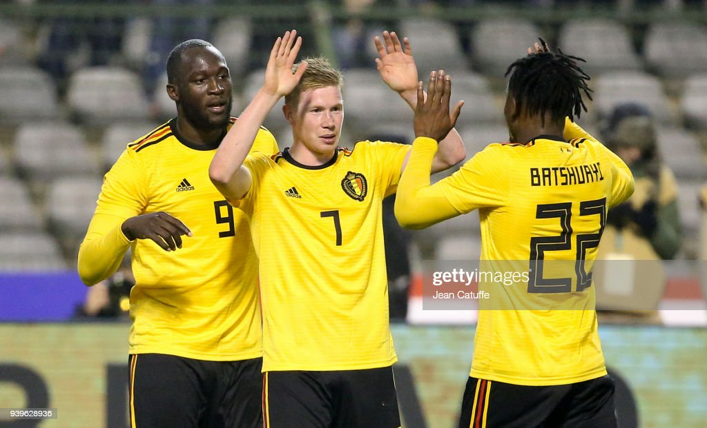 Kevin De Bruyne of Belgium celebrates his goal between Romelu Lukaku and Michy Batshuayi during the international friendly match between Belgium and Saudi Arabia on March 27, 2018 in Brussel, Belgium.