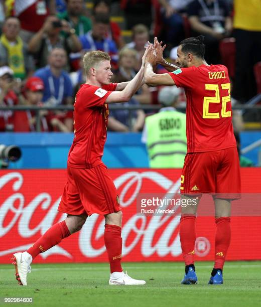 Kevin De Bruyne of Belgium celebrates with team mate Thomas MeunierNacer Chadli after scoring his team's second goal during the 2018 FIFA World Cup...