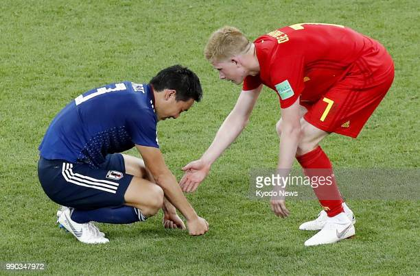 Kevin De Bruyne of Belgium commiserates with Gen Shoji of Japan after Belgium's 32 win in the World Cup round of 16 in RostovOnDon Russia on July 2...