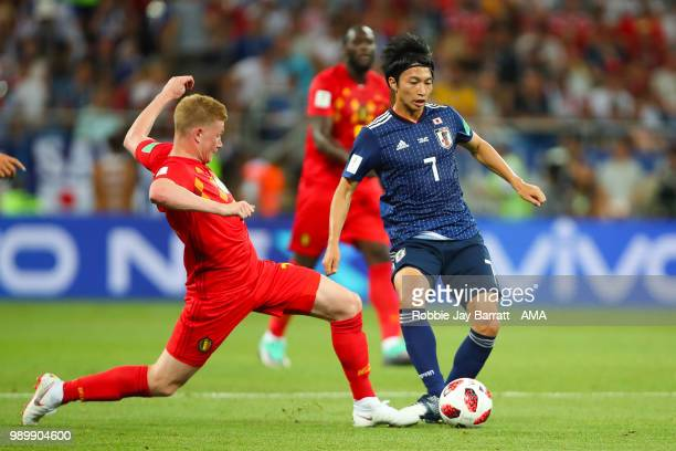 Kevin De Bruyne of Belgium competes with Gaku Shibasaki of Japan during the 2018 FIFA World Cup Russia Round of 16 match between Belgium and Japan at...