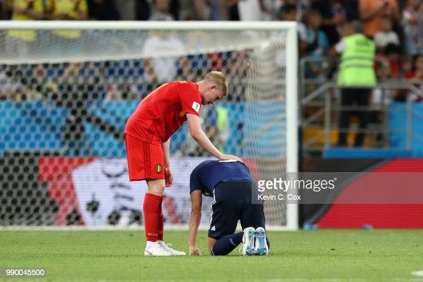 Kevin De Bruyne of Belgium consoles Gen Shoji of Japan following the 2018 FIFA World Cup Russia Round of 16 match between Belgium and Japan at Rostov...