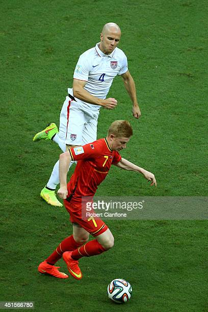 Kevin De Bruyne of Belgium controls the ball against Michael Bradley of the United States during the 2014 FIFA World Cup Brazil Round of 16 match...