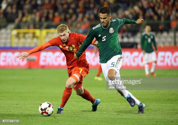 Kevin De Bruyne of Belgium Diego Reyes of Mexico during the international friendly match between Belgium and Mexico at King Baudouin Stadium on...