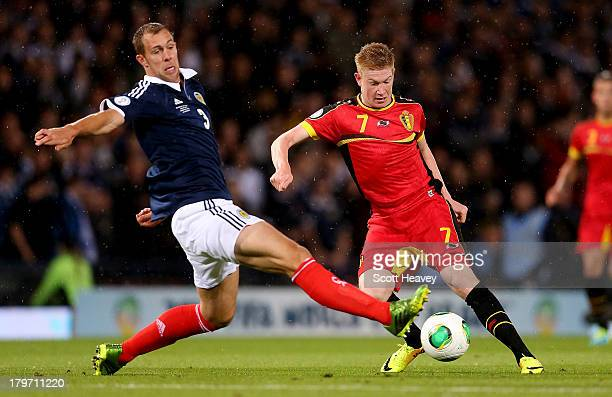 Kevin De Bruyne of Belgium evades Steven Whittaker of Scotland during the FIFA 2014 World Cup Qualifying Group A match between Scotland and Belgium...
