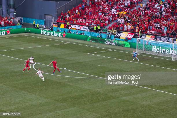 Kevin De Bruyne of Belgium has a shot on goal during the UEFA Euro 2020 Championship Group B match between Denmark and Belgium at Parken Stadium on...