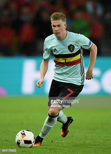 Kevin De Bruyne of Belgium in action during the UEFA EURO 2016 quarter final match between Wales and Belgium at Stade PierreMauroy on July 1 2016 in...