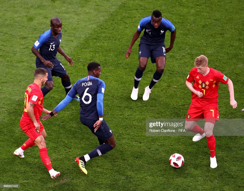 Kevin De Bruyne of Belgium is challenged by Paul Pogba, Ngolo Kante and Blaise Matuidi of France during the 2018 FIFA World Cup Russia Semi Final match between Belgium and France at Saint Petersburg Stadium on July 10, 2018 in Saint Petersburg, Russia.