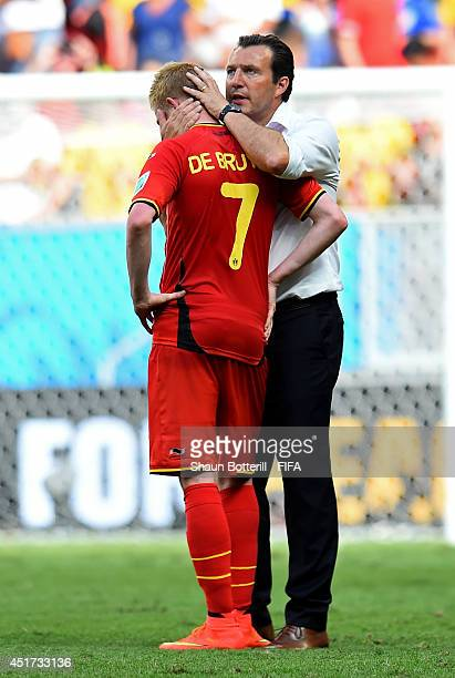 Kevin De Bruyne of Belgium is consoled by head coach Marc Wilmots of Belgium after the 01 defeat in the 2014 FIFA World Cup Brazil Quarter Final...