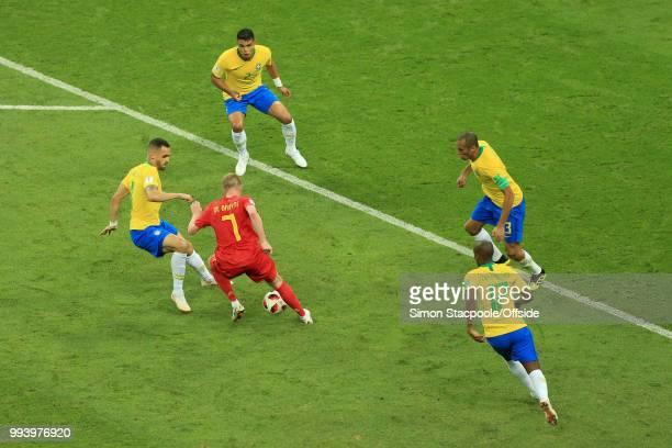 Kevin De Bruyne of Belgium is surrounded by Brazilian opponents during the 2018 FIFA World Cup Russia Quarter Final match between Brazil and Belgium...