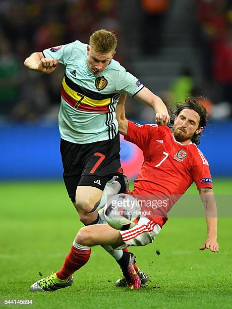 Kevin De Bruyne of Belgium is tackled by Joe Allen of Wales during the UEFA EURO 2016 quarter final match between Wales and Belgium at Stade...
