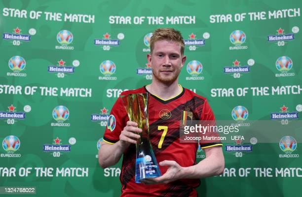 """Kevin De Bruyne of Belgium poses for a photograph with their Heineken """"Star of the Match"""" award after the UEFA Euro 2020 Championship Group B match..."""