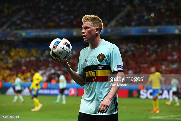 Kevin De Bruyne of Belgium removes the second ball from the pitch during the UEFA EURO 2016 Group E match between Sweden and Belgium at Allianz...