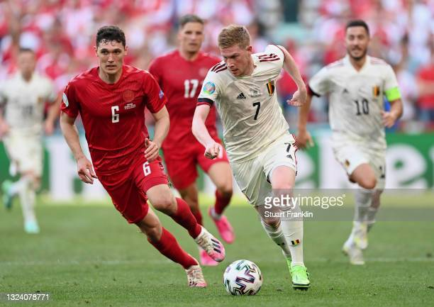 Kevin De Bruyne of Belgium runs with the ball whilst under pressure from Andreas Christensen of Denmark during the UEFA Euro 2020 Championship Group...