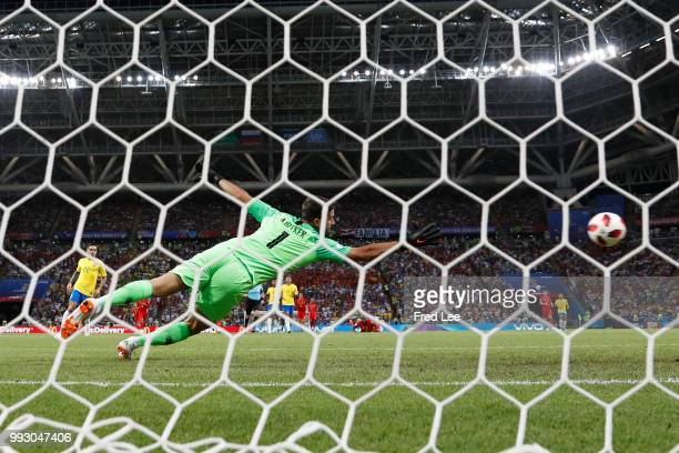 Kevin De Bruyne of Belgium scores past Alisson of Brazil his team's second goal during the 2018 FIFA World Cup Russia Quarter Final match between...