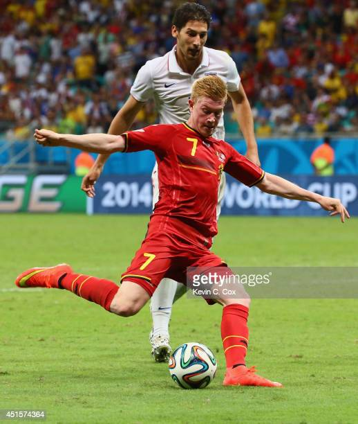 Kevin De Bruyne of Belgium shoots and scores his team's first goal in extra time during the 2014 FIFA World Cup Brazil Round of 16 match between...