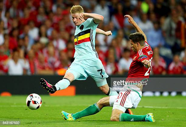 Kevin De Bruyne of Belgium shoots at goal while Richard Guzmics of Hungary tries to block during the UEFA EURO 2016 round of 16 match between Hungary...