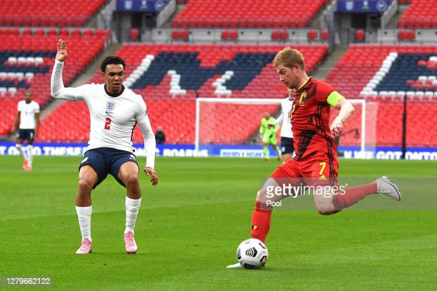 Kevin De Bruyne of Belgium shoots past Trent Alexander-Arnold of England during the UEFA Nations League group stage match between England and Belgium...