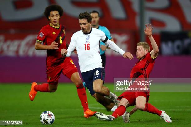 Kevin De Bruyne of Belgium tackles Jack Grealish of England during the UEFA Nations League group stage match between Belgium and England at King...