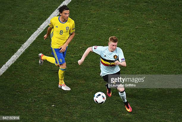 Kevin De Bruyne of Belgium takes the ball away fromm Albin Ekdal of Sweden during the UEFA EURO 2016 Group E match between Sweden and Belgium at...