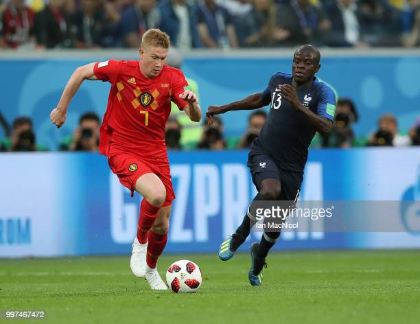 Kevin De Bruyne of Belgium vies with Ngolo Kante of France during the 2018 FIFA World Cup Russia Semi Final match between Belgium and France at Saint...