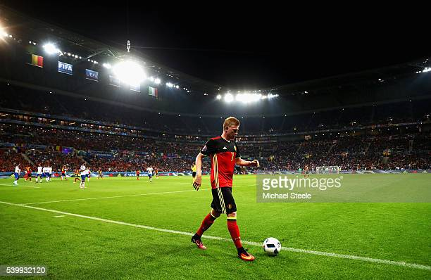 Kevin De Bruyne of Belgium walks to take a corner kick during the UEFA EURO 2016 Group E match between Belgium and Italy at Stade des Lumieres on...