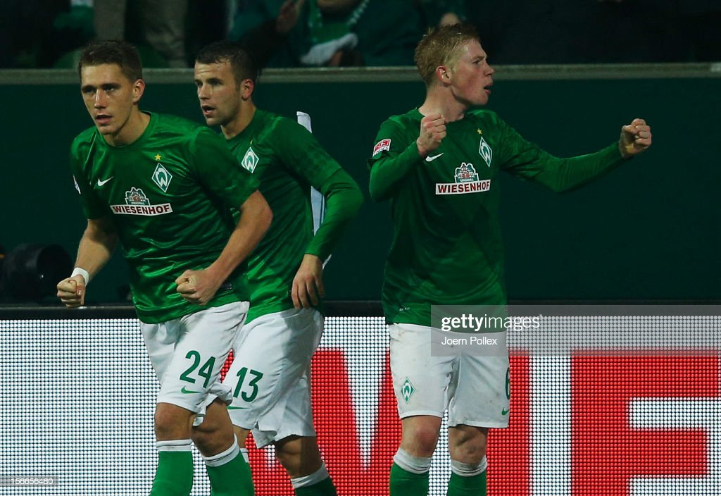 Kevin De Bruyne (R) of Bremen celebrates with his team mates after scoring his team's second goal during the Bundesliga match between SV Werder Bremen and Fortuna Duesseldorf at Weser Stadium on November 18, 2012 in Bremen, Germany.