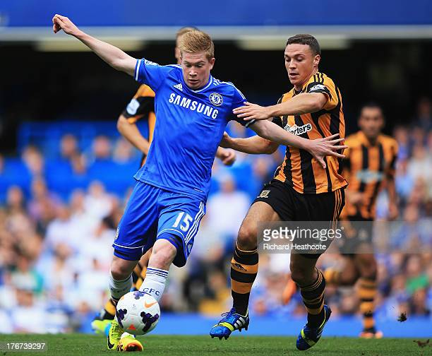 Kevin De Bruyne of Chelsea is challenged by James Chester of Hull City during the Barclays Premier League match between Chelsea and Hull City at...