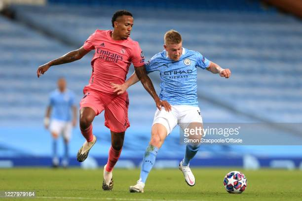 Kevin de Bruyne of Man City battles with Eder Militao of Real Madrid during the UEFA Champions League round of 16 second leg match between Manchester...