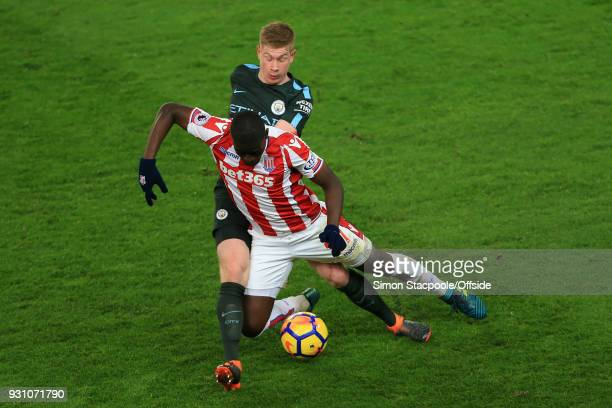Kevin De Bruyne of Man City battles with Papa Alioune Ndiaye of Stoke during the Premier League match between Stoke City and Manchester City at the...