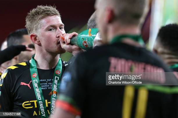 Kevin De Bruyne of Man City drinks champagne during the Carabao Cup Final between Aston Villa and Manchester City at Wembley Stadium on March 1 2020...
