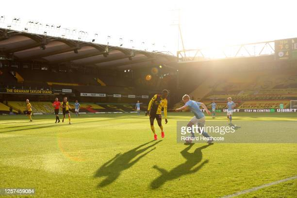 Kevin De Bruyne of Man City goes past Ismaïla Sarr of Watford during the Premier League match between Watford FC and Manchester City at Vicarage Road...