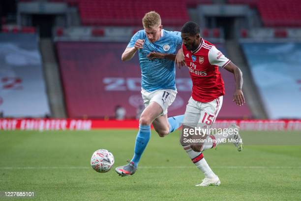 Kevin De Bruyne of Manchester City and Ainsley MaitlandNiles of Arsenal in action during the FA Cup Semi Final match between Arsenal and Manchester...