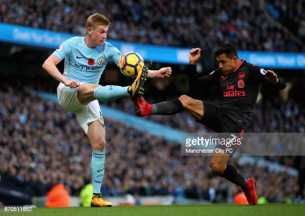 Kevin De Bruyne of Manchester City and Alexis Sanchez of Arsenal battle for possession during the Premier League match between Manchester City and...