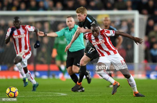 Kevin De Bruyne of Manchester City and Bruno Martins Indi of Stoke City battle for the ball during the Premier League match between Stoke City and...