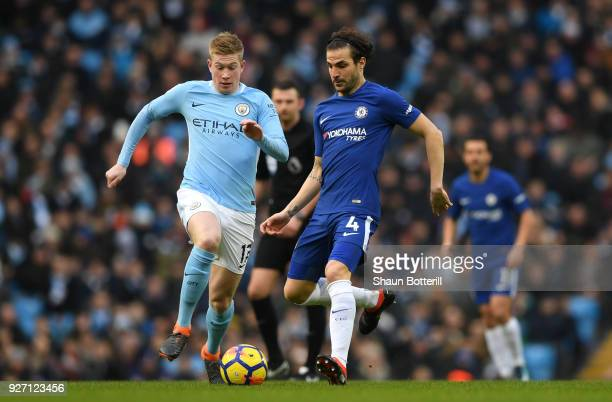 Kevin De Bruyne of Manchester City and Cesc Fabregas of Chelsea battle for the ball during the Premier League match between Manchester City and...