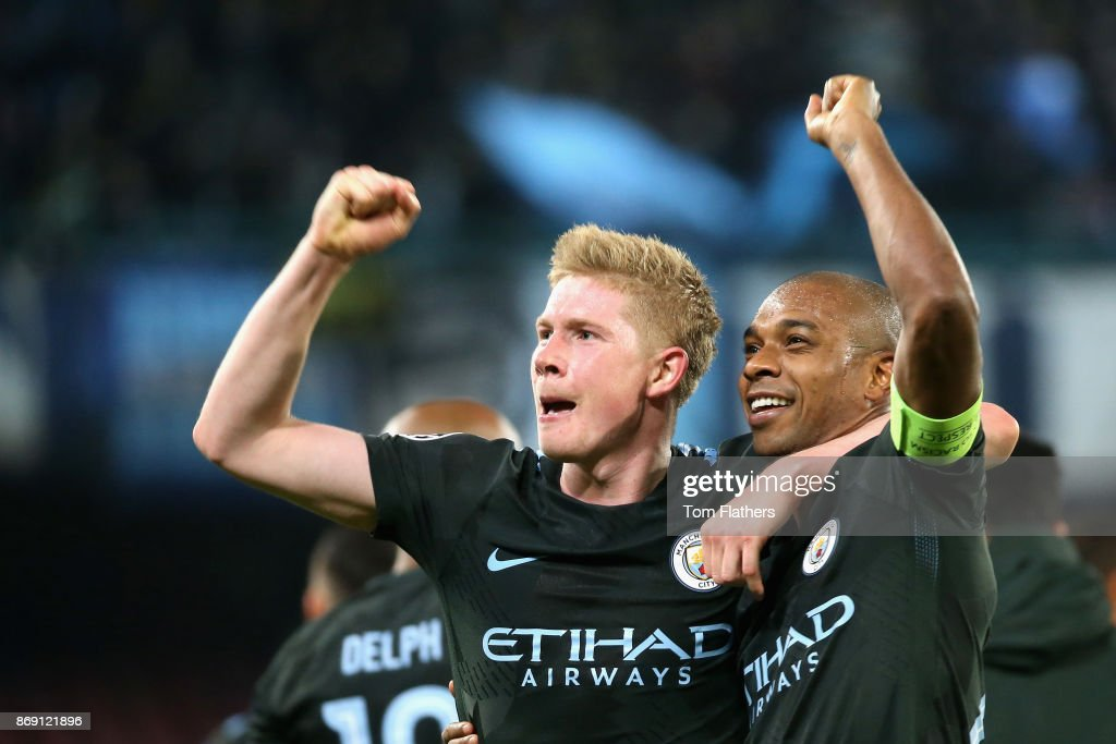 Kevin De Bruyne of Manchester City and Fernandinho of Manchester City celebrate victory after the UEFA Champions League group F match between SSC Napoli and Manchester City at Stadio San Paolo on November 1, 2017 in Naples, Italy.