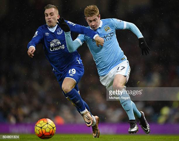 Kevin de Bruyne of Manchester City and Gerard Deulofeu of Everton compete for the ball during the Barclays Premier League match between Manchester...