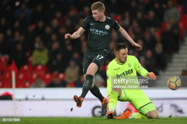 Kevin De Bruyne of Manchester City and Jack Butland of Stoke City during the Premier League match between Stoke City and Manchester City at Bet365...
