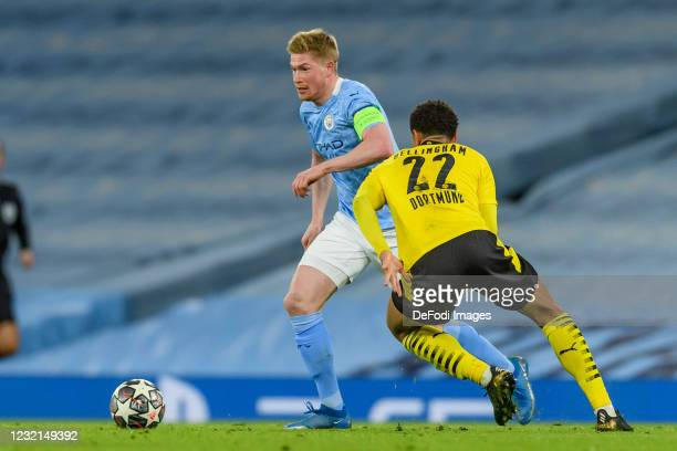 Kevin De Bruyne of Manchester City and Jude Bellingham of Borussia Dortmund battle for the ball during the UEFA Champions League Quarter Final match...