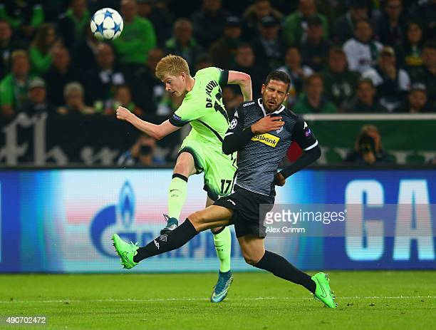 Kevin de Bruyne of Manchester City and Álvaro Domínguez of Borussia Monchengladbach battle for the ball during the UEFA Champions League Group D...
