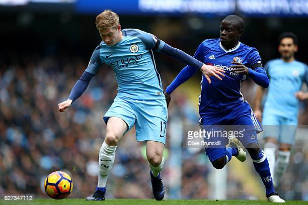 Kevin De Bruyne of Manchester City and N'Golo Kante of Chelsea compete for the ball during the Premier League match between Manchester City and...