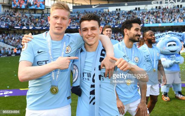 Kevin De Bruyne of Manchester City and Phil Foden of Manchester City celebrate winning the premier league after the Premier League match between...