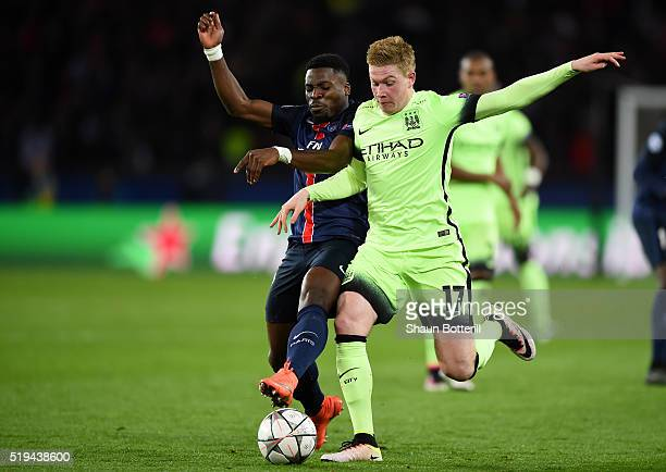 Kevin de Bruyne of Manchester City and Serge Aurier of Paris SaintGermain compete for the ball during the UEFA Champions League Quarter Final First...
